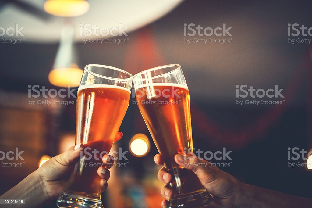 Two friends with glasses of beer. Shallow DOF stock photo
