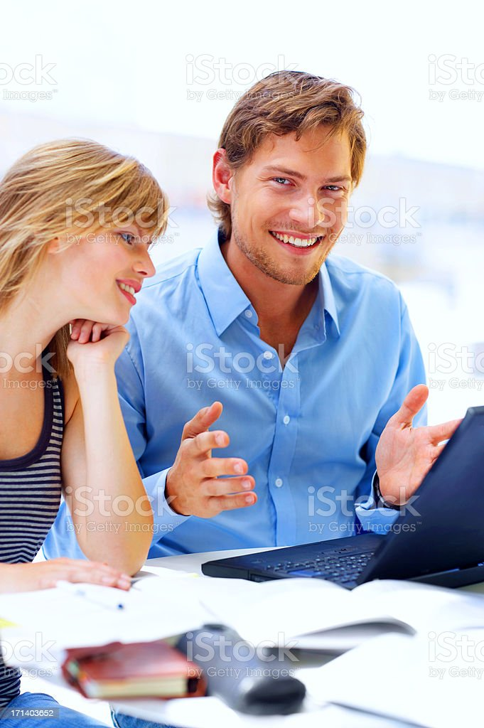 Two friends working on laptop royalty-free stock photo