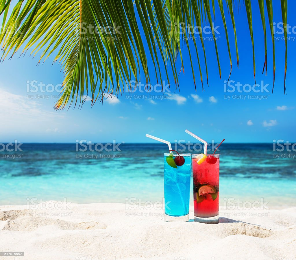 Two fruity cocktails at tropical sunny beach stock photo