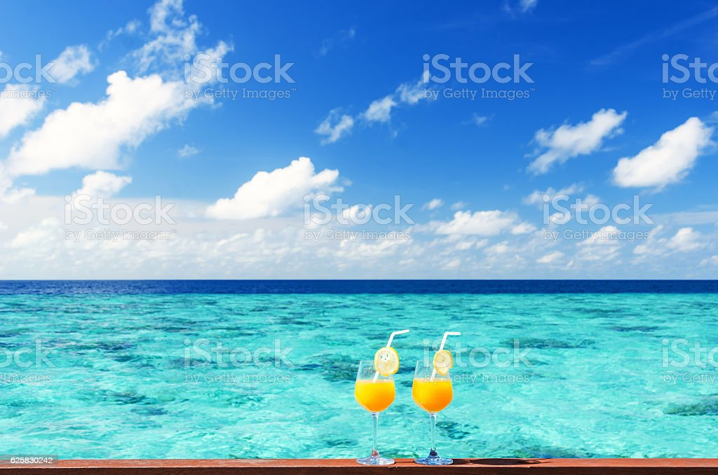 Two fruity cocktails on the sea view terrace stock photo