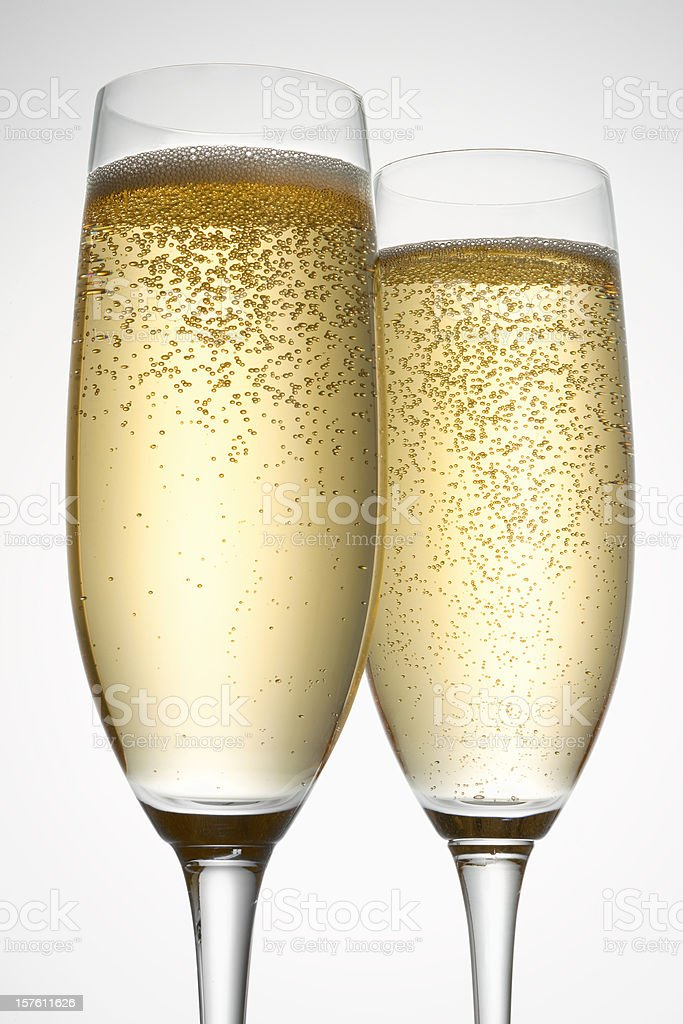Two full champagne flutes stock photo