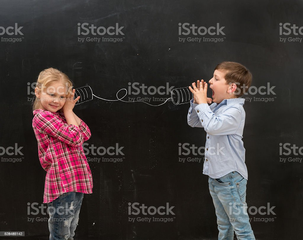 two funny children talking on self-made drawn telephone stock photo