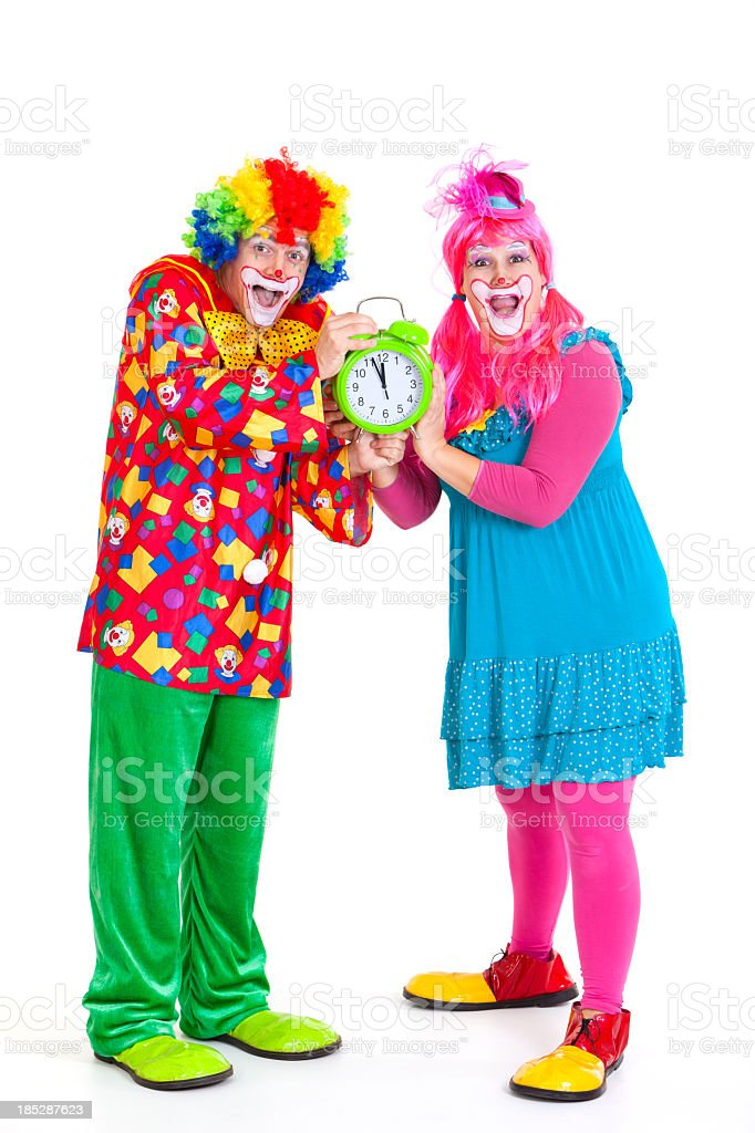 Two funny clowns with clock royalty-free stock photo