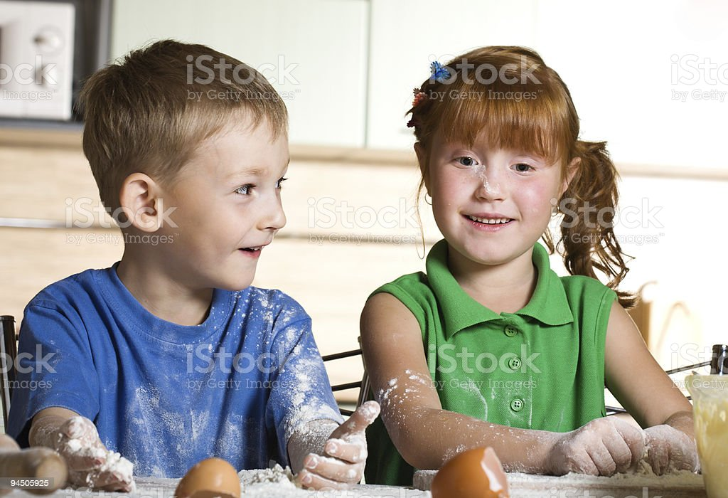 Two funny cooks royalty-free stock photo