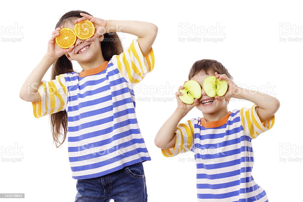Two funny kids with fruits on face royalty-free stock photo
