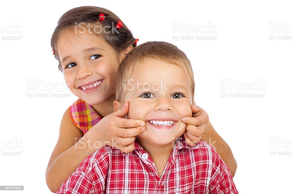 Two funny smiling little children stock photo