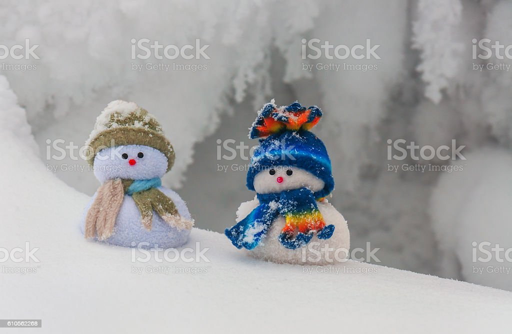 two funny snowmans stock photo