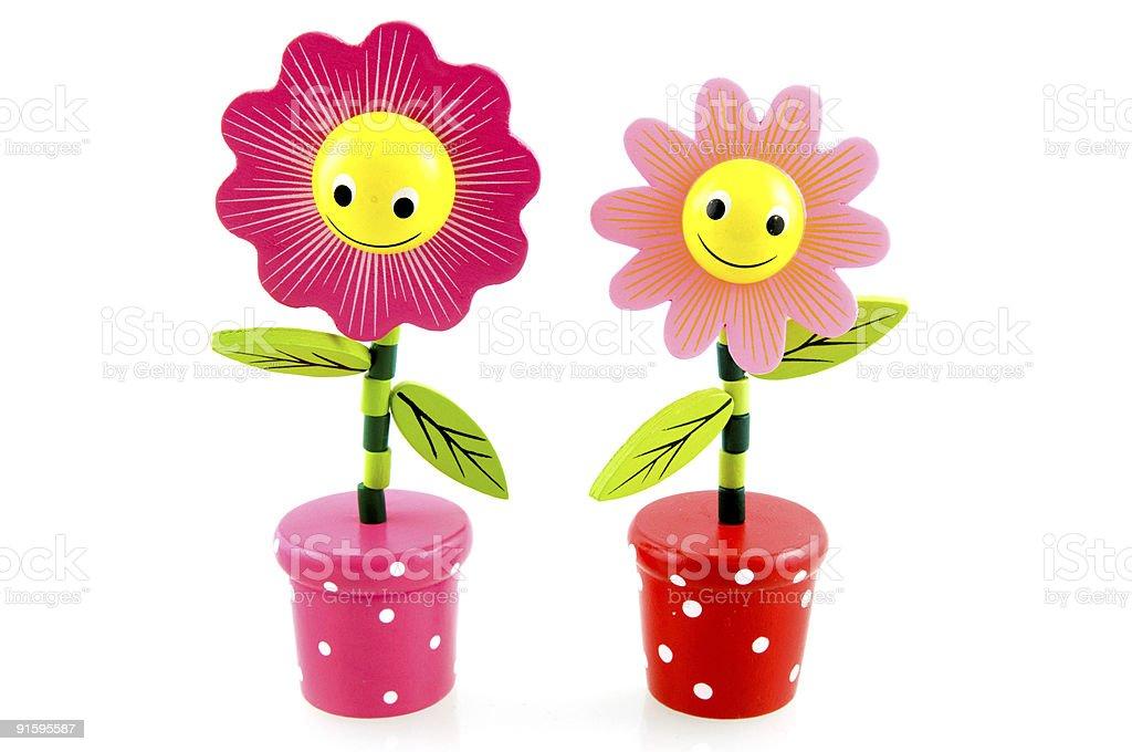 Deux drôle en bois fleurs photo libre de droits