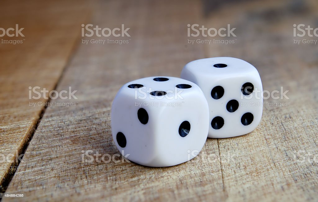 Two game cubes on a horizontal surface. stock photo