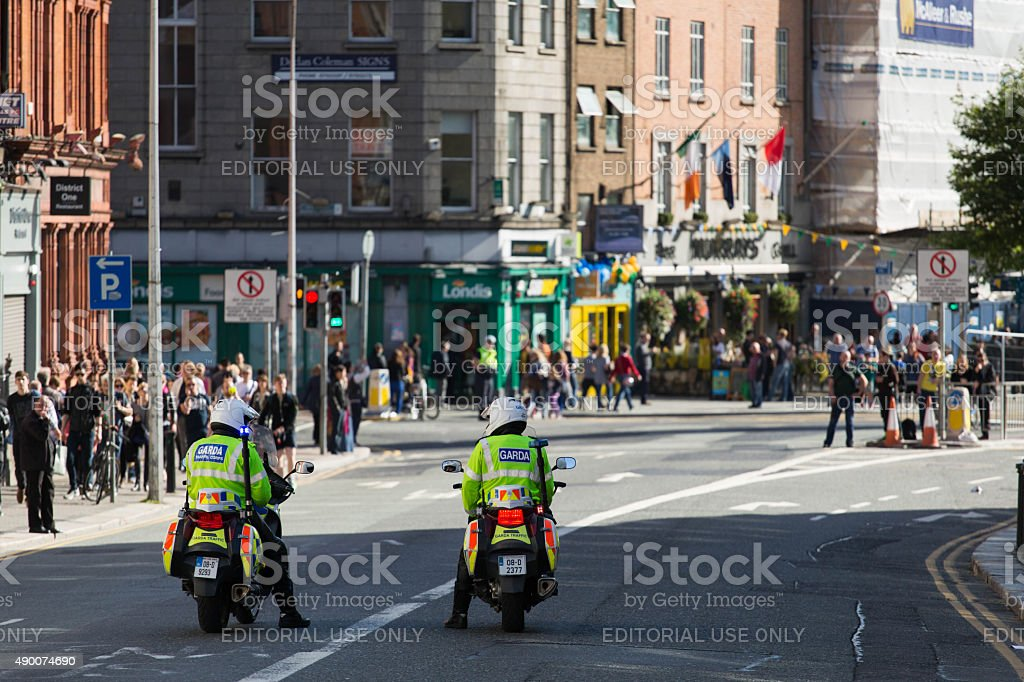 Two garda traffic officers heading to O'Connell Street stock photo