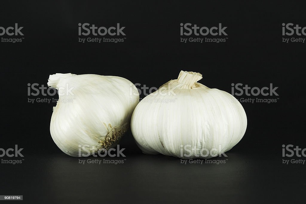 Two garlic bulbs royalty-free stock photo