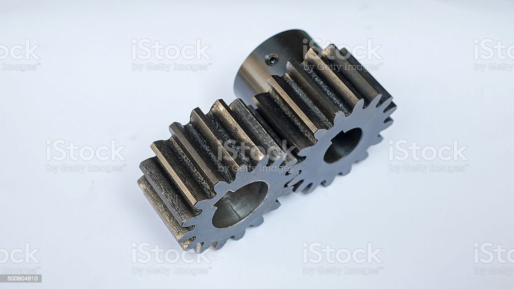 two gear on white background, selective focus stock photo