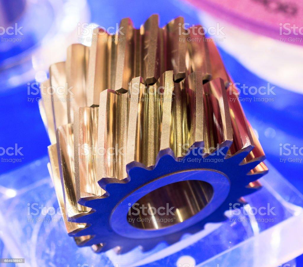 Two gears with cut slanting teeth stock photo