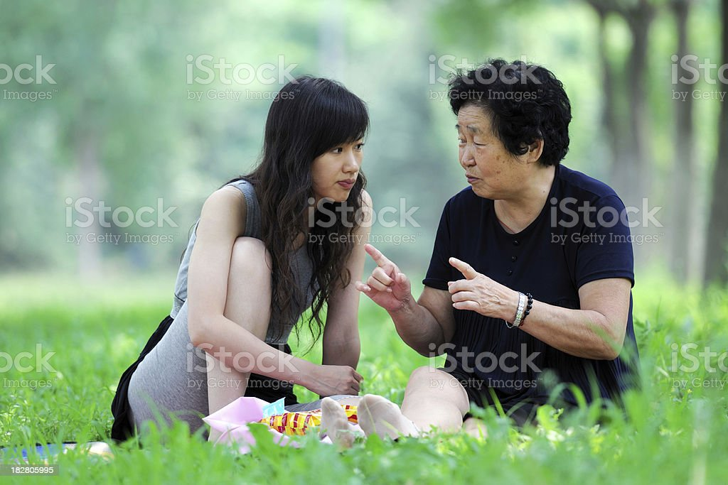 Two Generation Asian People Picnic and Talking - XLarge royalty-free stock photo