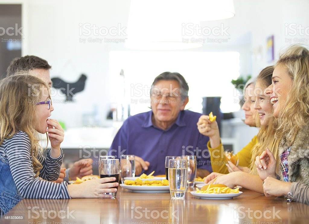 Two generation family having lunch royalty-free stock photo