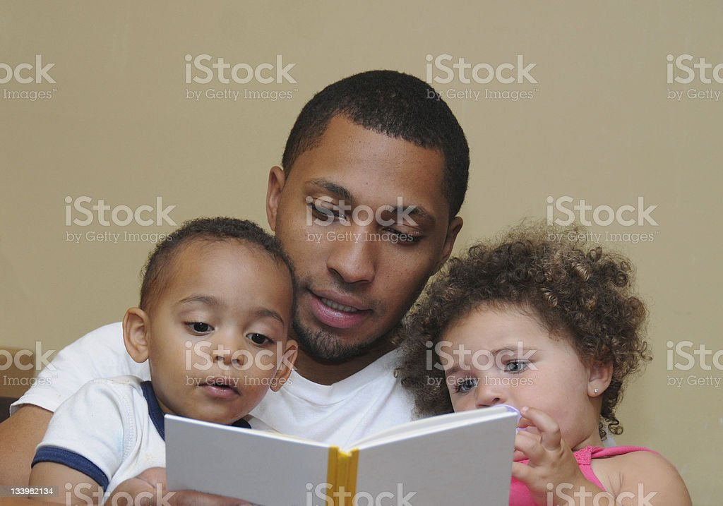 Two Generation Family Reading Father Son Niece stock photo