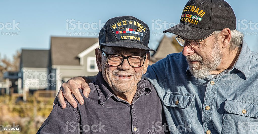 Two Generation Family USA Military War Veteran Senior Men stock photo
