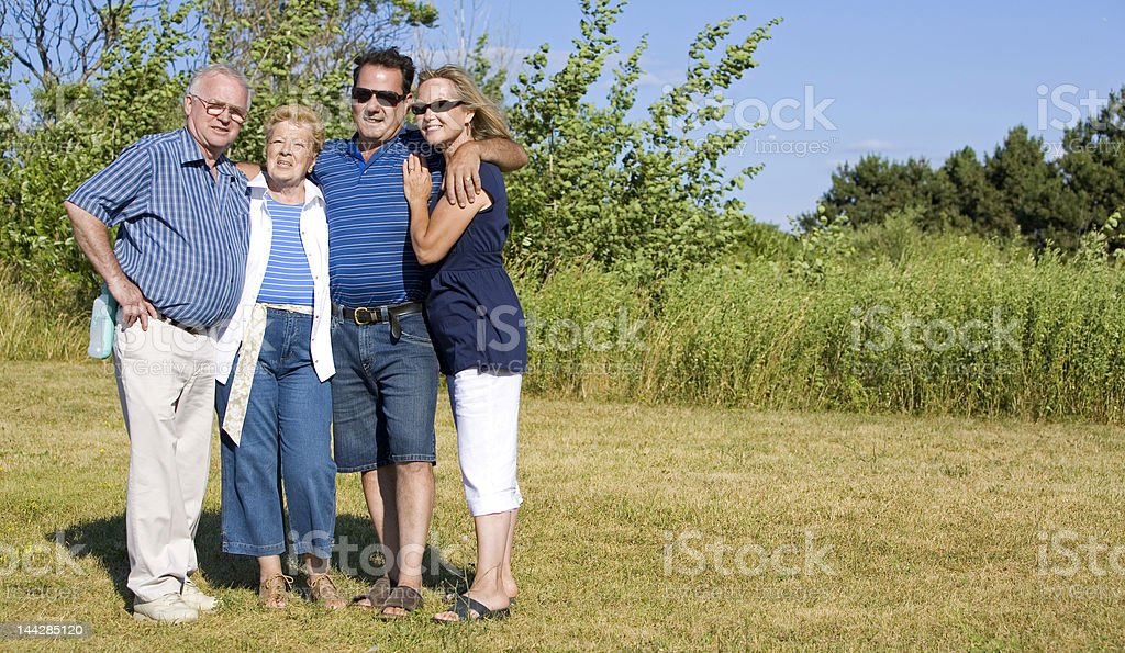 Two generational family posing for photo outdoor royalty-free stock photo