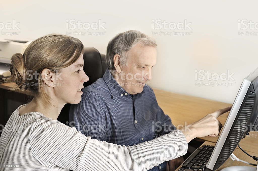 Two generations at computer royalty-free stock photo