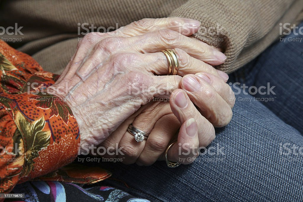 Two Generations embracing and Holding Hands - Grandmother Daughter royalty-free stock photo