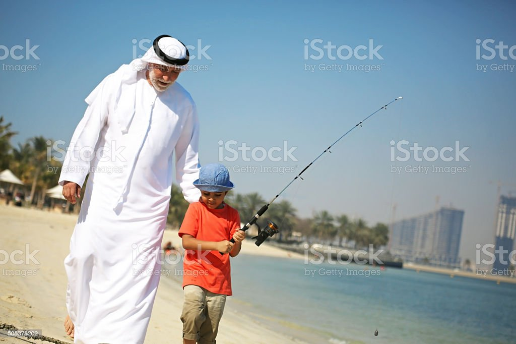 Two generations fishing together stock photo