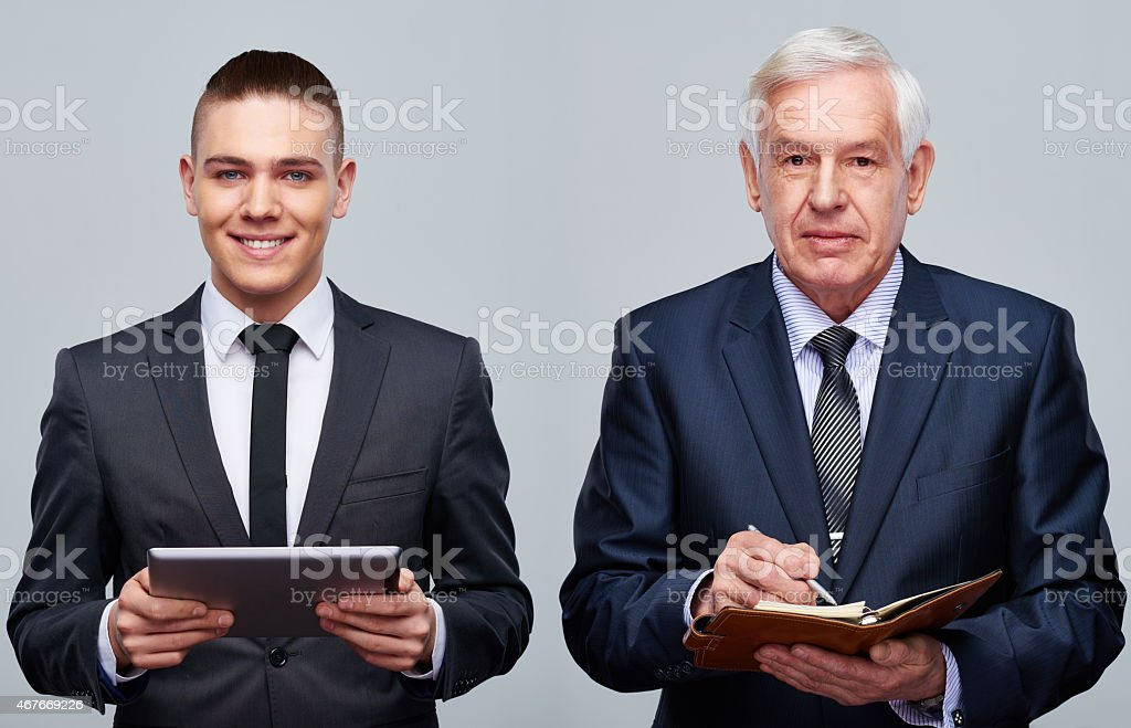 Two generations of businessmen stock photo