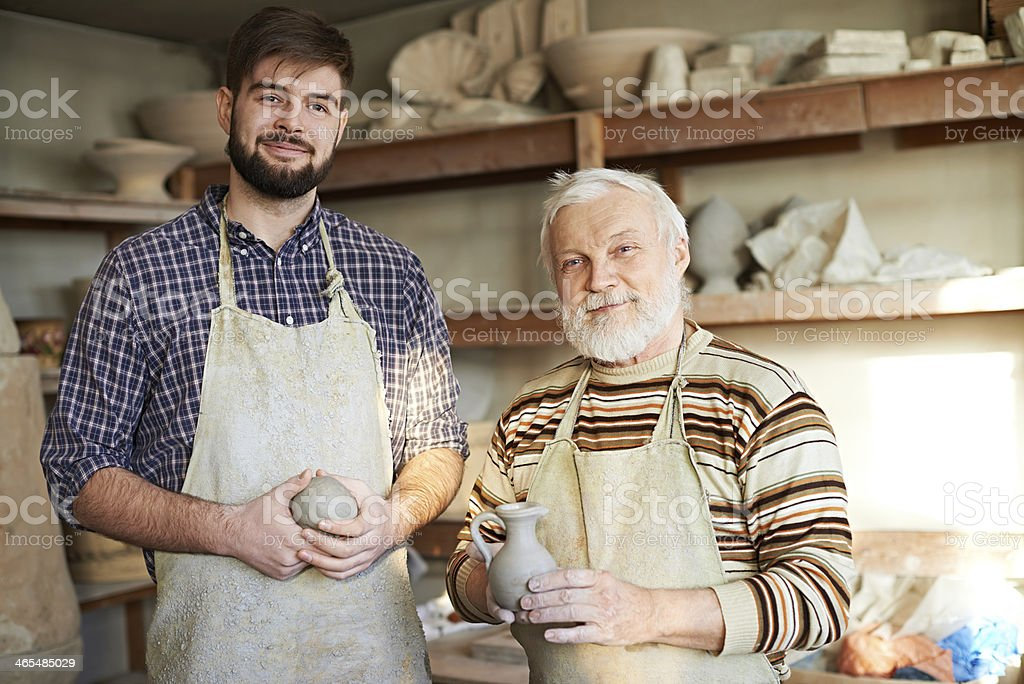 Two generations of potters royalty-free stock photo