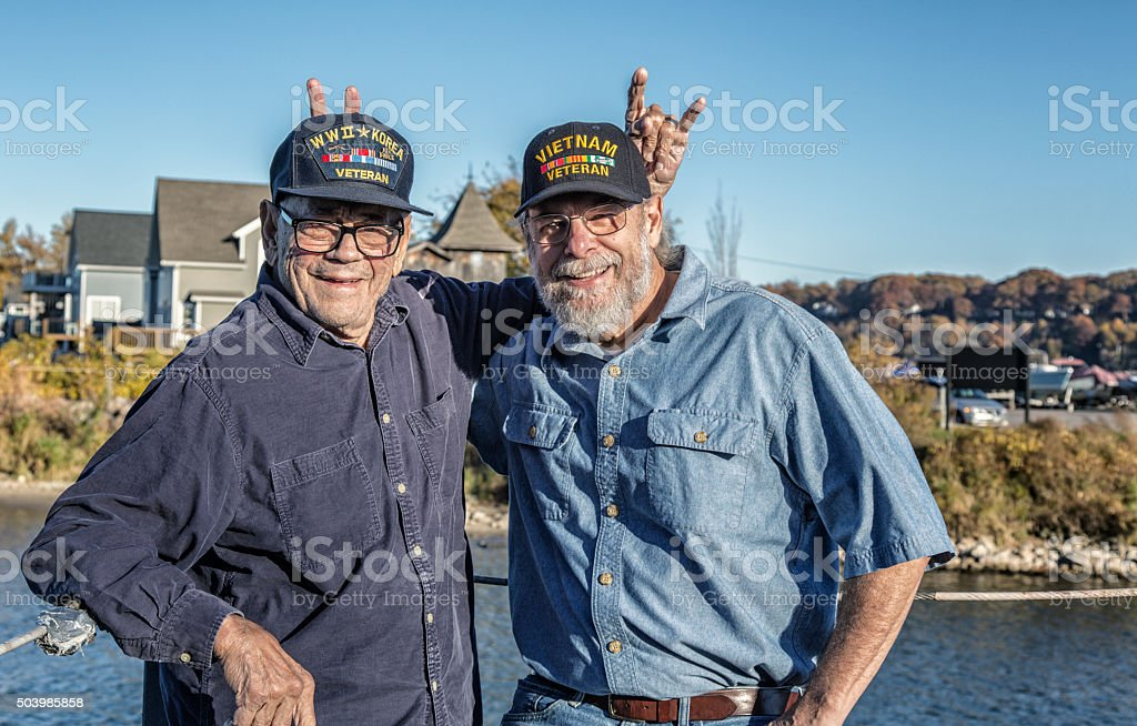 Two Generations Of Rabbit Ears USA Military War Veterans stock photo