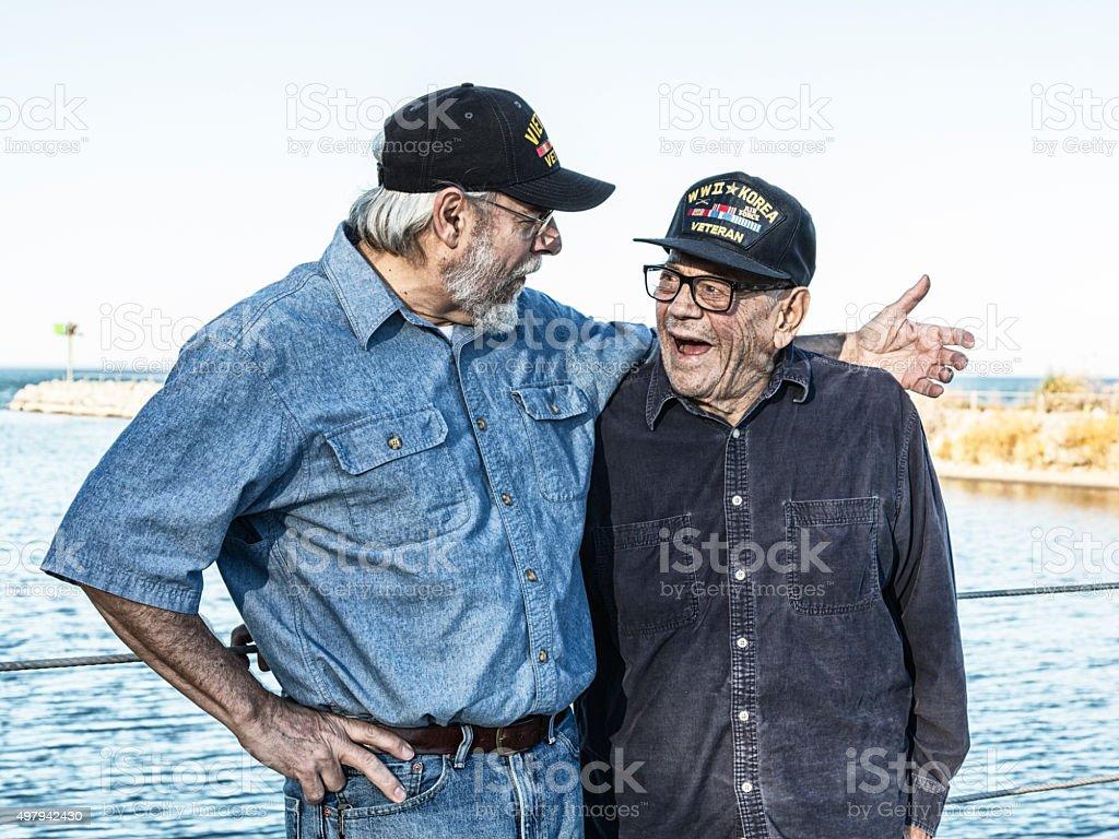 Two Generations Of USA Military War Veterans Telling Jokes stock photo