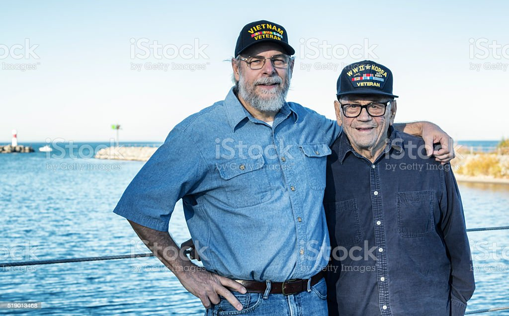 Two Generations USA Military War Veteran Family Men stock photo