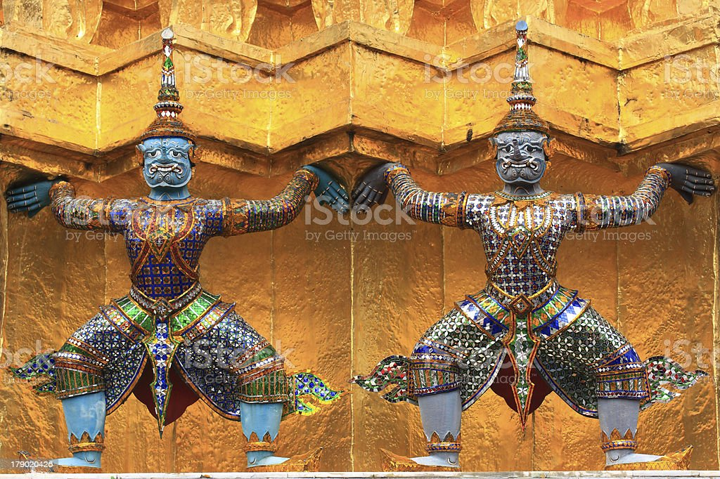 Two Giants with Gold Pagoda royalty-free stock photo