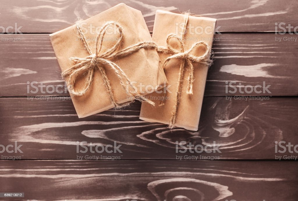 Two gift on the old wooden background stock photo