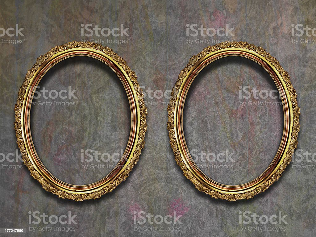 Two Gilded Frames on Old Wallpaper royalty-free stock photo