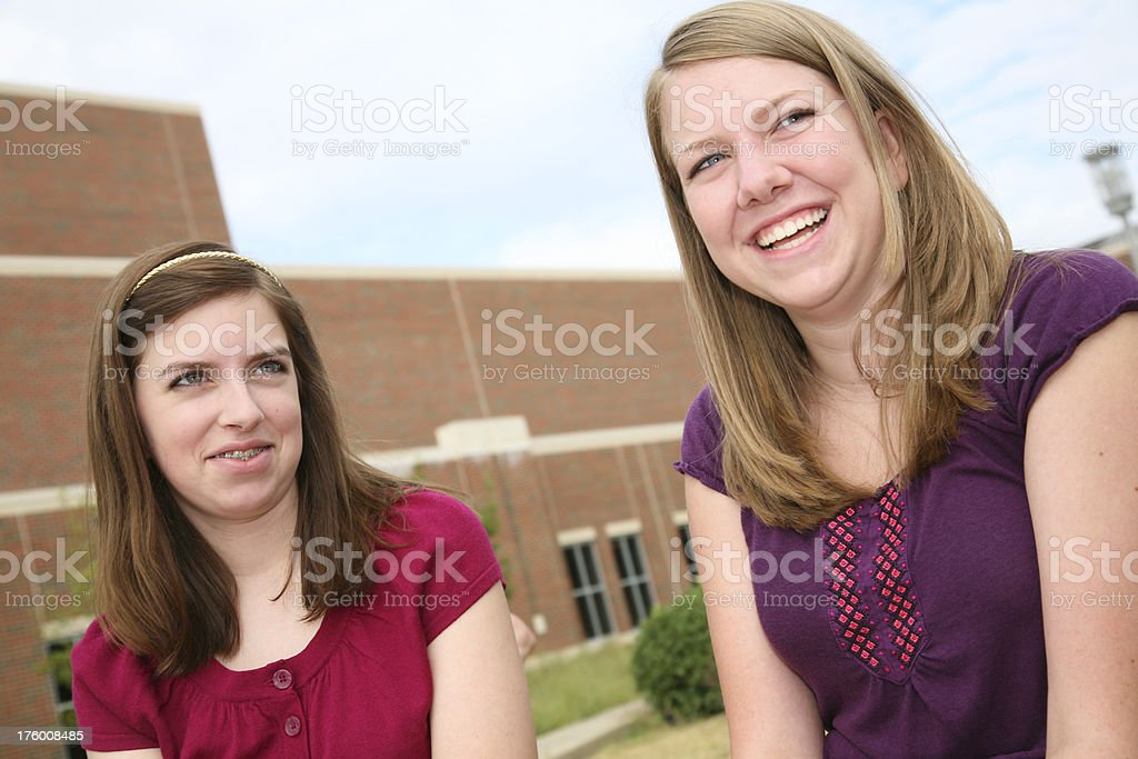 Two Girl Friends Laughing Together at School royalty-free stock photo