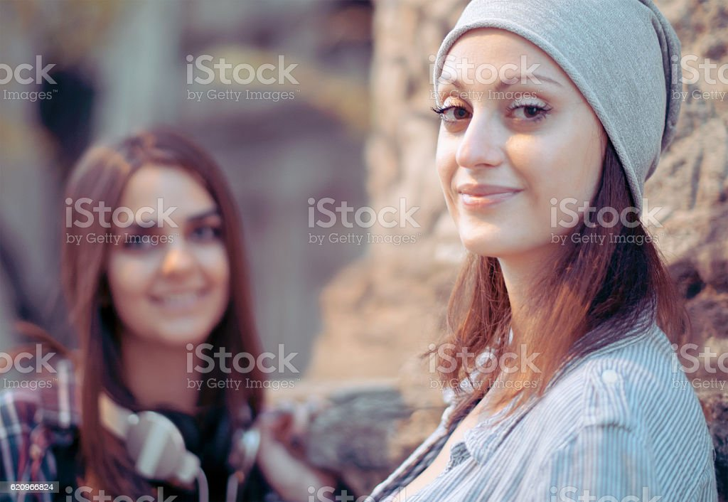 Two girl friends popular look stock photo