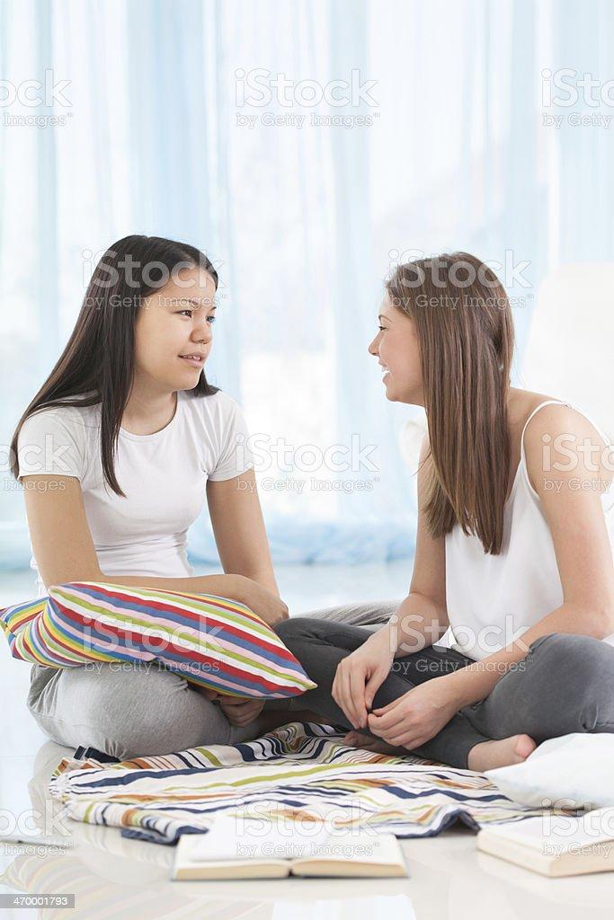 Two girl friends talking stock photo
