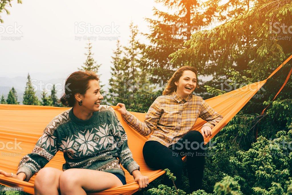 Two girl in hammock stock photo