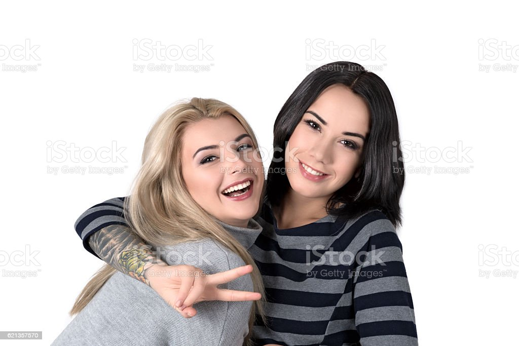 two  girlfriend blonde and brunette laugh stock photo