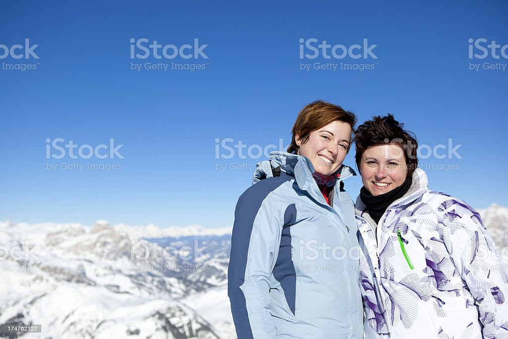 Two girlfriends having funny ski day royalty-free stock photo