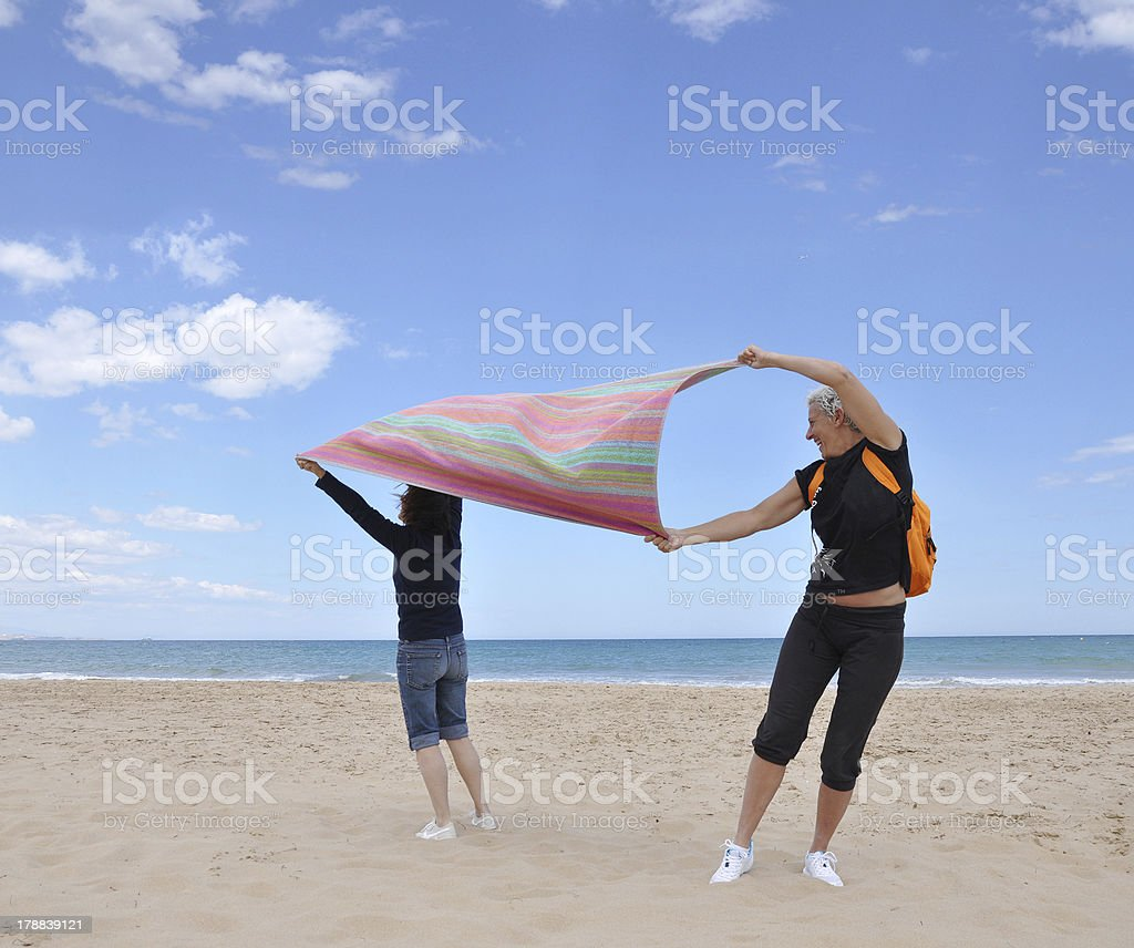 Two Girlfriends on Beach Playing royalty-free stock photo