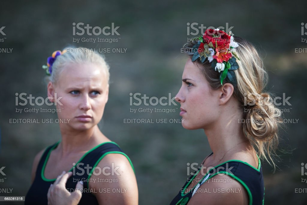 Two girls a pause in the general rehearsal concert. stock photo