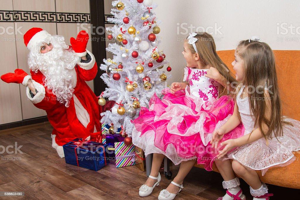 Two girls ambush for Santa Claus stock photo