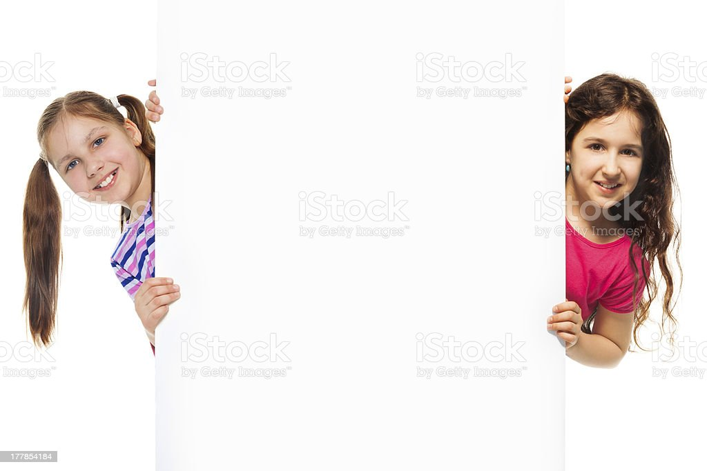 Two girls and information billboard royalty-free stock photo
