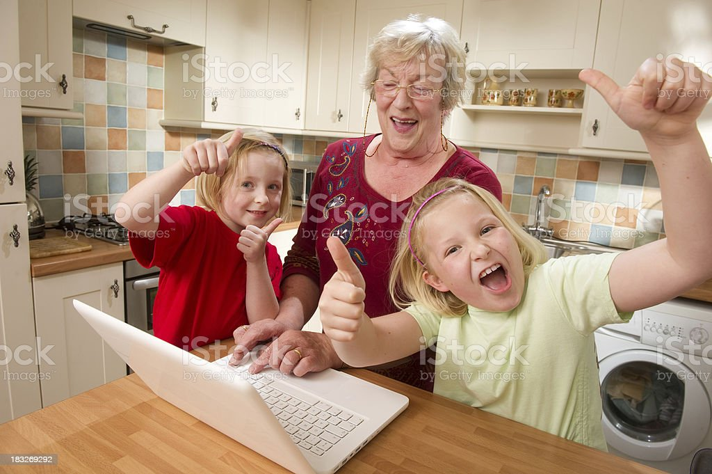 Two Girls and Their Grandmother at a Laptop royalty-free stock photo