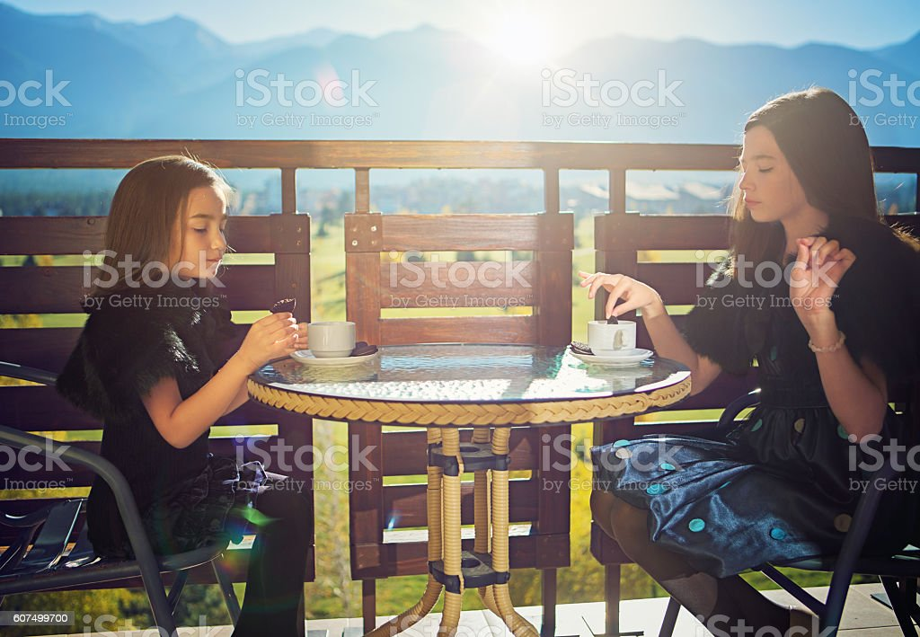 Two girls are making party at the balcony stock photo