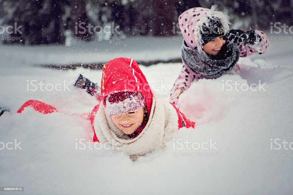 Two girls are playing in the snow stock photo
