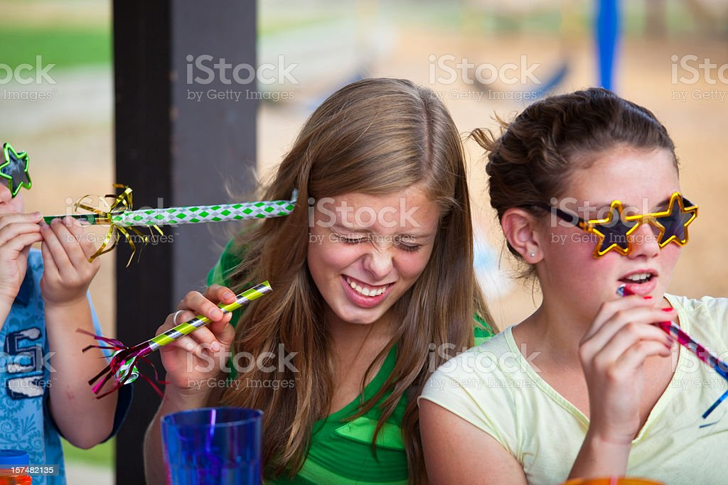 Two Girls at a Teenage Girl's Birthday Party royalty-free stock photo