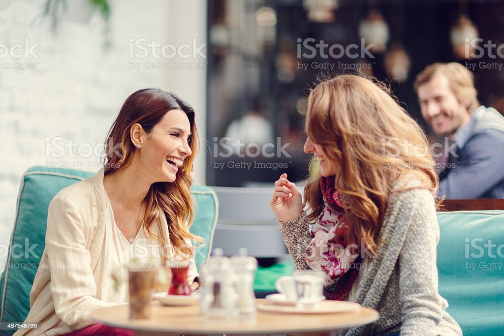 Two girls at sidewalk cafe in Istanbul stock photo