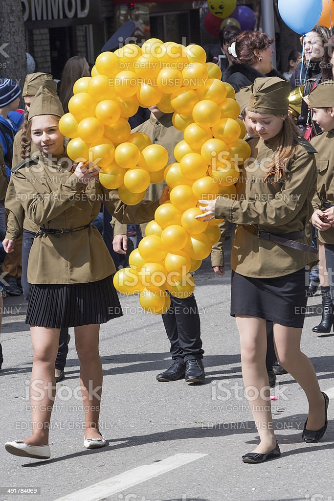 Two girls at the parade with balloons royalty-free stock photo