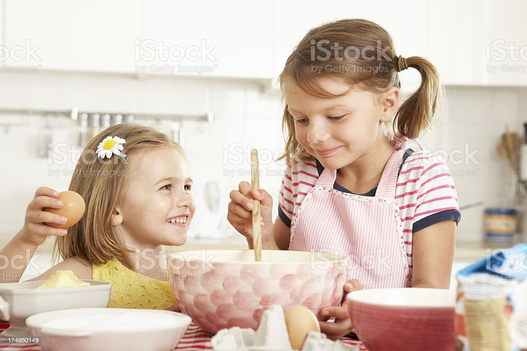 Two Girls Baking In Kitchen royalty-free stock photo